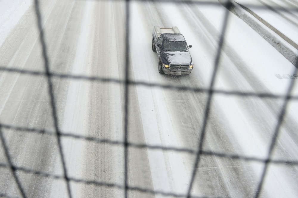 . Vehicles travel on I-25 as seen from the Steele Street overpass. Snow is expected to fall throughout the day. (Photo by AAron Ontiveroz/The Denver Post)