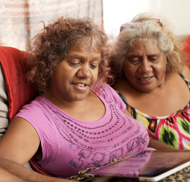 Two Aboriginal Women Looking at a Computer Tablet