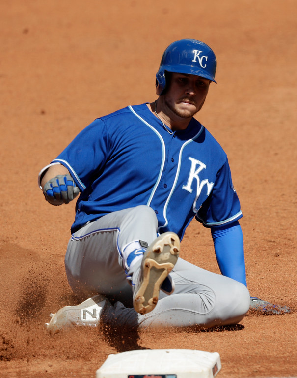 . Kansas City Royals\' Ryan O\'Hearn slides into third base for a triple in the fourth inning of a baseball game against the Cleveland Indians, Wednesday, Sept. 5, 2018, in Cleveland. (AP Photo/Tony Dejak)