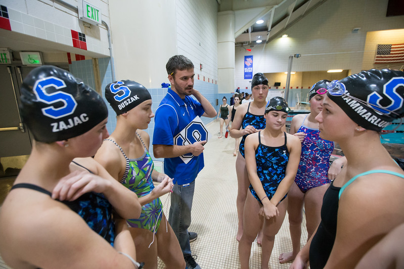 Southington's head coach Evan Tuttle talks with swimmers Tuesday during the CIAC Class LL swimming finals at the Freeman Athletic Center Natatorium on the campus of Wesleyan University in Middletown November 14, 2017 | Justin Weekes / For the Record-Journal