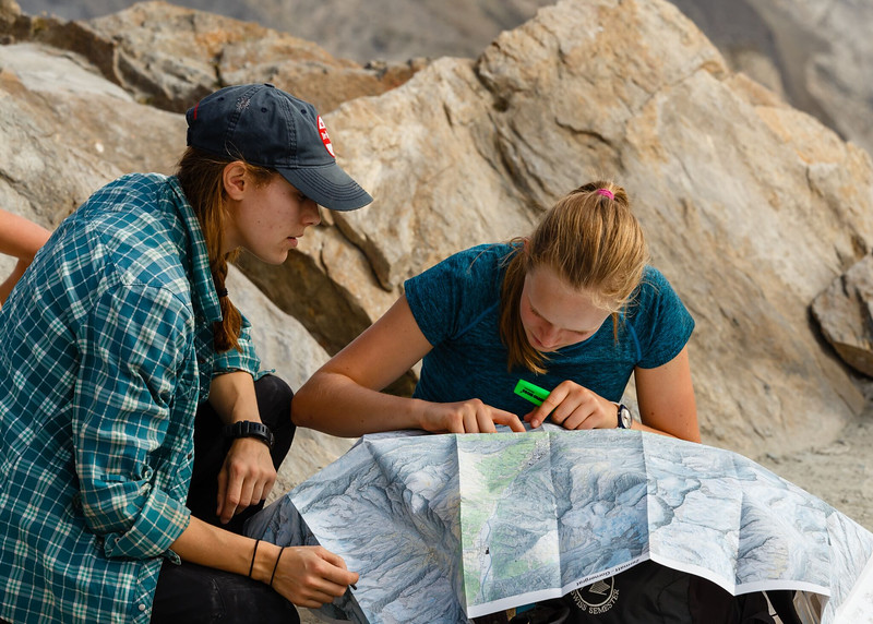 Ms. Perry helping Abigael with her map