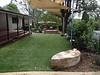 sandstone gum leaf seat with artificial turf and shade sails