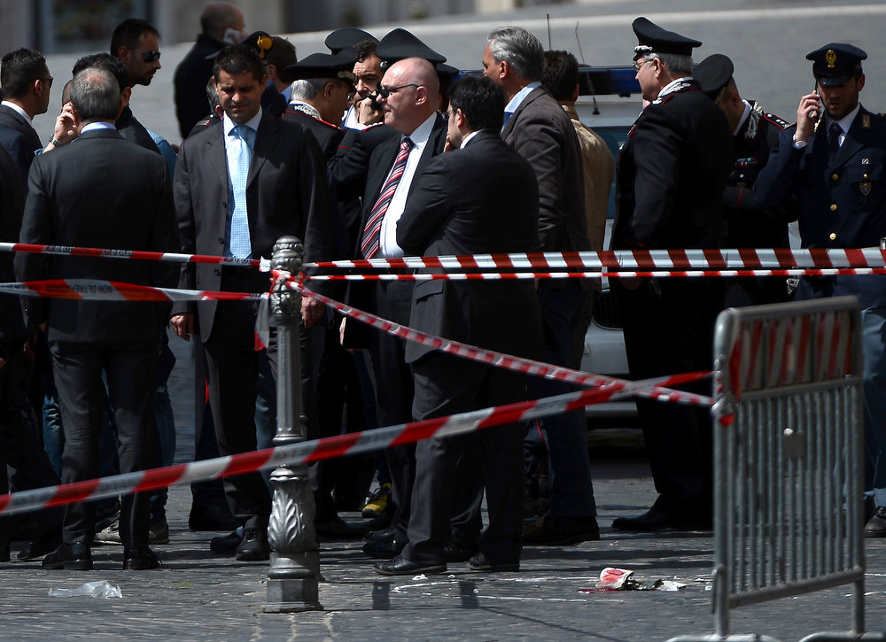 . Policemen stand near the area where a Carabiniere police officer was shot by an apparently disturbed man, on April 28, 2013 in Rome, outside the palazzo Chigi, the Italian Prime minister offices, while the country\'s new ministers were being sworn in. Two policemen were wounded, as well as a passerby, in the shooting. The attacker, named by Italian media as businessman Luigi Preiti, 49, was tackled to the ground by by police as witnesses fled the scene.   FILIPPO MONTEFORTE/AFP/Getty Images