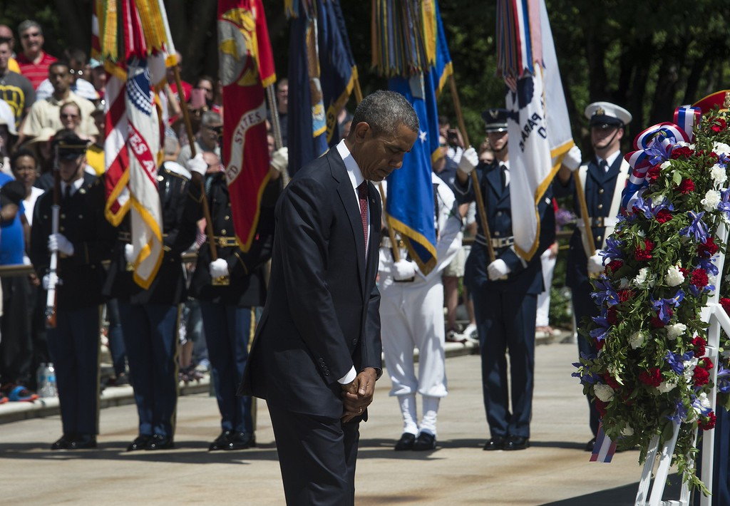 . US President Barack Obama pauses after placing a wreath at the Tomb of the Unknowns during Memorial Day ceremonies on May 25, 2015 at Arlington National Cemetery in Arlington, Virginia. Memorial Day, originally called Decoration Day, is a day of remembrance for those who have died in service of the United States of America.   NICHOLAS KAMM/AFP/Getty Images