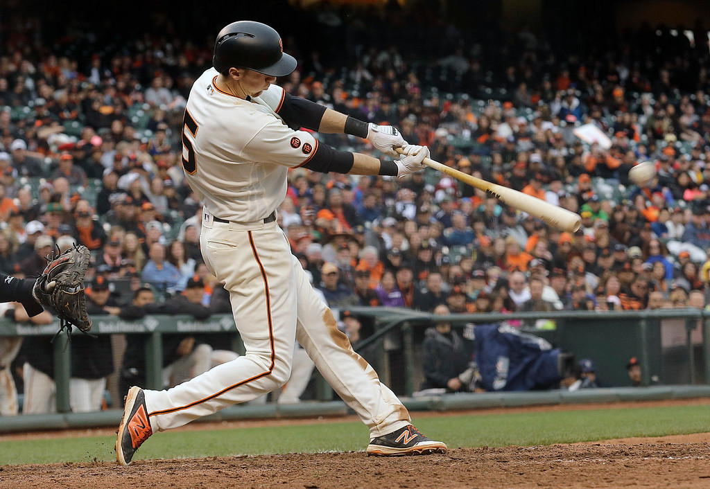 . San Francisco Giants\' Matt Duffy hits a double to score Conor Gillaspie for the winning run against the Colorado Rockies during the thirteenth inning of a baseball game in San Francisco, Saturday, May 7, 2016. The Giants won 2-1. (AP Photo/Jeff Chiu)