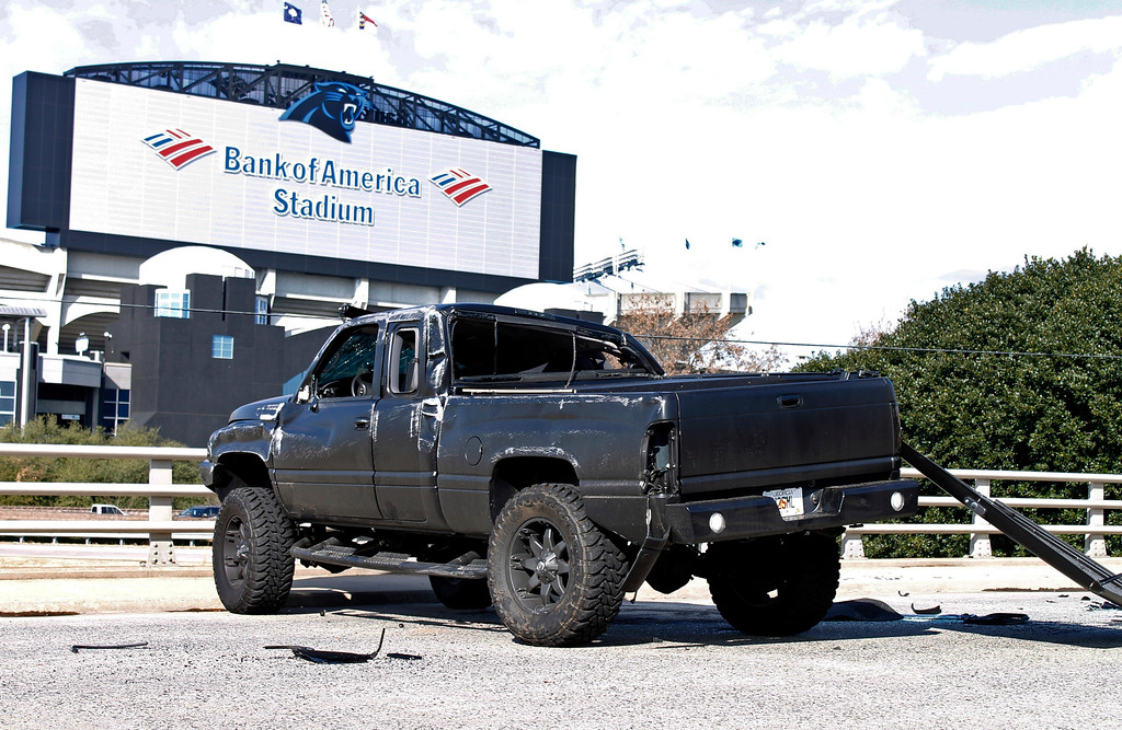 . The damaged truck driven by Carolina Panthers quarterback Cam Newton sits near Bank of America Stadium after the quarterback was involved in an accident, Tuesday, Dec. 9, 2014, in Charlotte, N.C. Newton was taken to the hospital. (AP Photo/Skip Foreman)