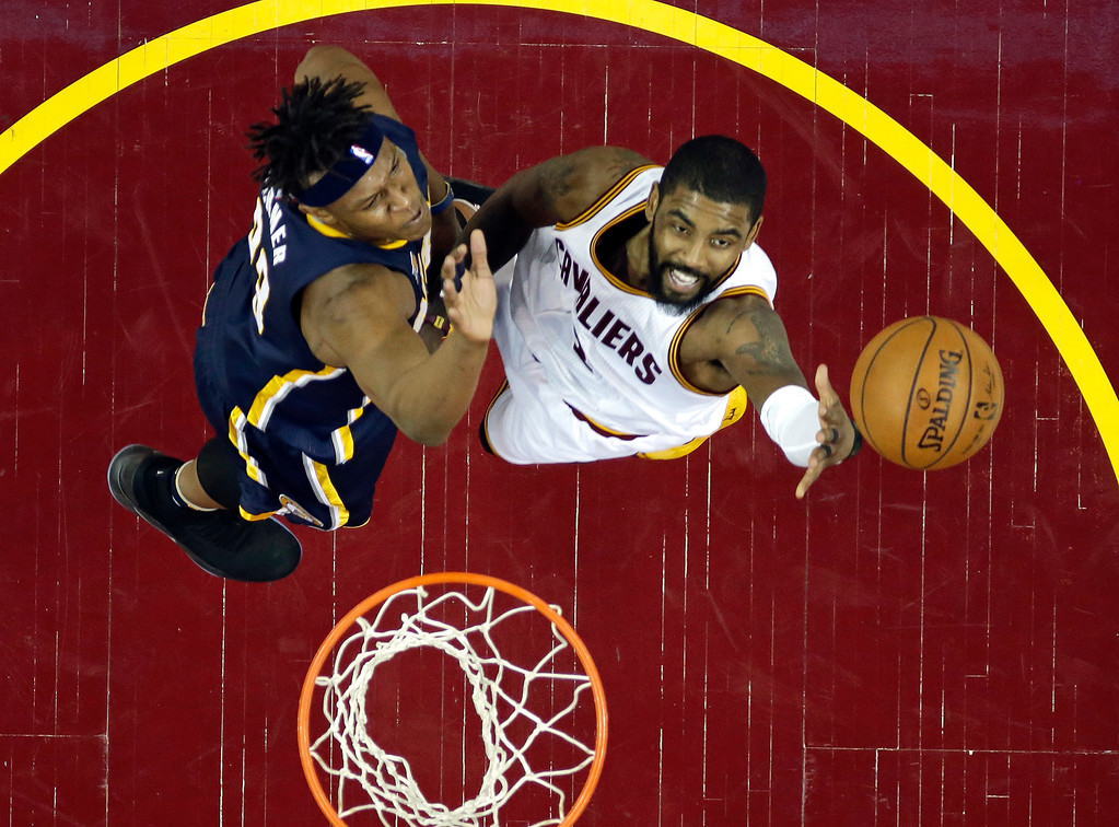 . Cleveland Cavaliers\' Kyrie Irving, right, drives to the basket against Indiana Pacers\' Myles Turner in the first half in Game 2 of the first round of the NBA playoffs on April 17 in Cleveland. The Cavaliers won 117-111, to lead the series 2-0. Irving led the Cavs in points (37), LeBron James led in assists (7) and Kevin Love in rebounds (11). (AP Photo/Tony Dejak)