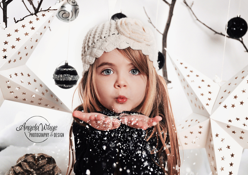 Girl Blowing White Christmas Snowflakes in Studio