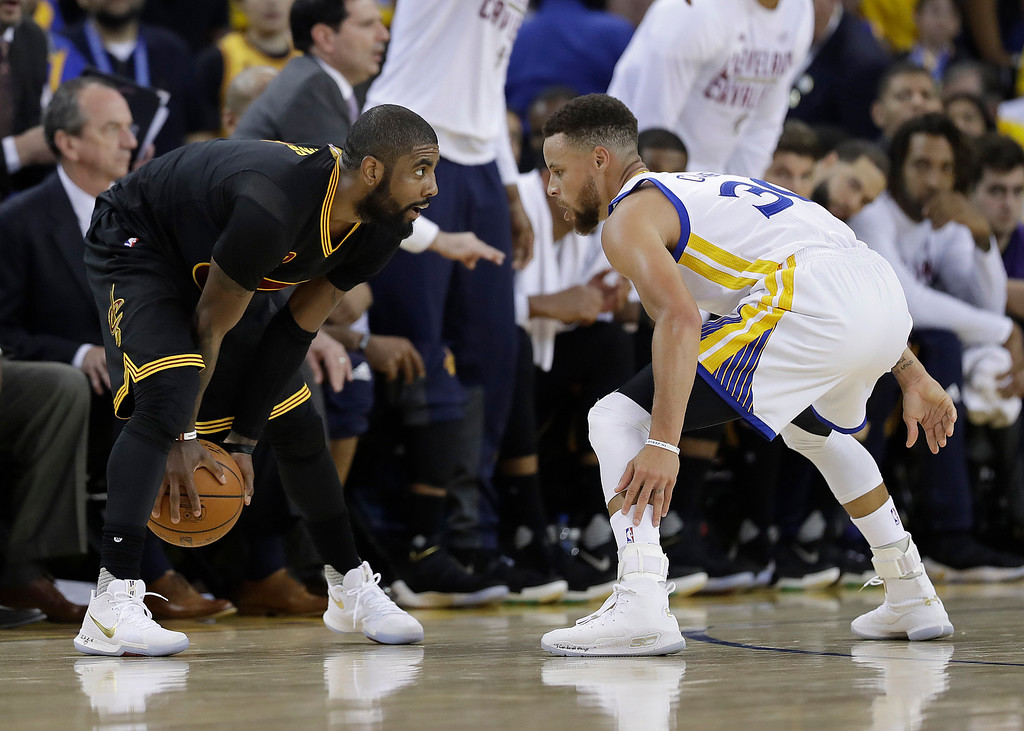 . Cleveland Cavaliers guard Kyrie Irving, left, faces Golden State Warriors guard Stephen Curry during the first half of Game 2 of basketball\'s NBA Finals in Oakland, Calif., Sunday, June 4, 2017. (AP Photo/Marcio Jose Sanchez)