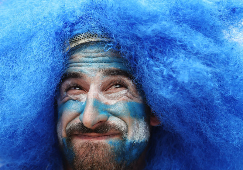 . A Uruguay supporter waits for the start of the group D World Cup soccer match between Italy and Uruguay at the Arena das Dunas in Natal, Brazil, Tuesday, June 24, 2014. (AP Photo/Petr David Josek)