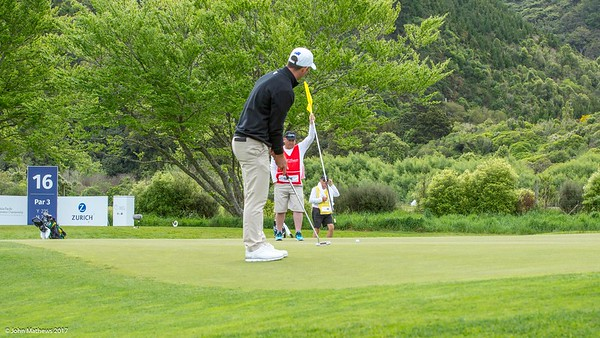 Charlie Dann putting the ball on the 15th green on the 1st day of competition in the Asia-Pacific Amateur Championship tournament 2017 held at Royal Wellington Golf Club, in Heretaunga, Upper Hutt, New Zealand from 26 - 29 October 2017. Copyright John Mathews 2017.   www.megasportmedia.co.nz