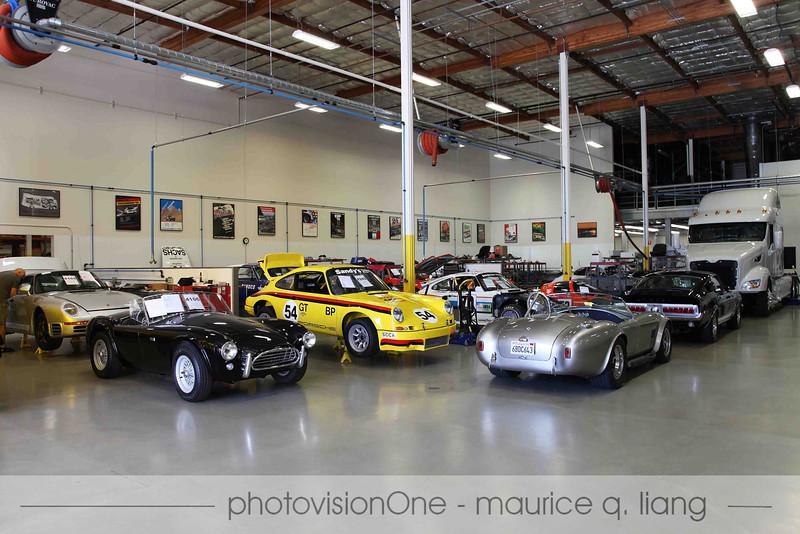 Inside Canepa's shop.  Porsche 959, a real Cobra, Porsche race cars, Shelby Mustangs.