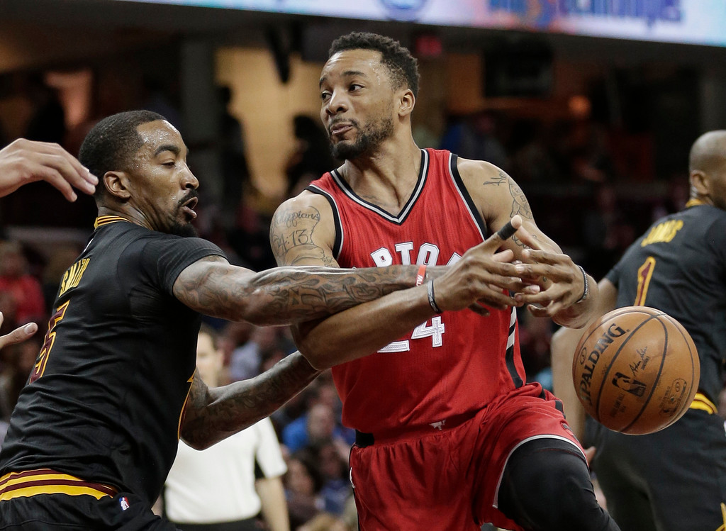 . Cleveland Cavaliers\' J.R. Smith, left, knocks the ball loose from Toronto Raptors\' Norman Powell in the second half of an NBA basketball game, Wednesday, April 12, 2017, in Cleveland. The Raptors won 98-83. (AP Photo/Tony Dejak)