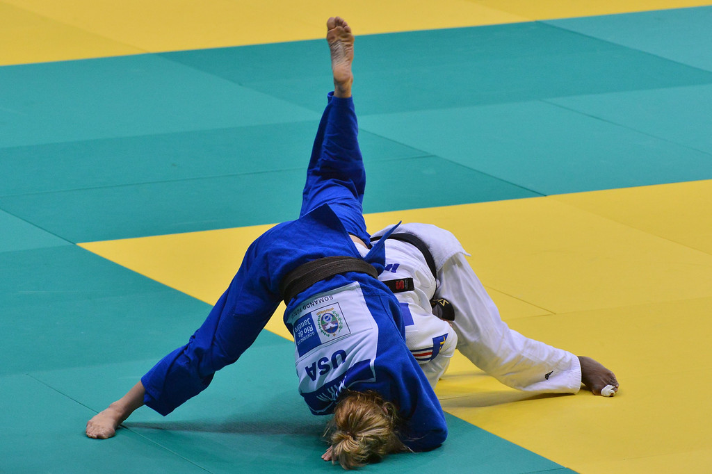 . US judoka Hannah Martin (L) competes with France\'s Gervise Emane in the Women\'s -63kg category, during the IJF World Judo Championship, in Rio de Janeiro, Brazil, on August 29, 2013. YASUYOSHI CHIBA/AFP/Getty Images
