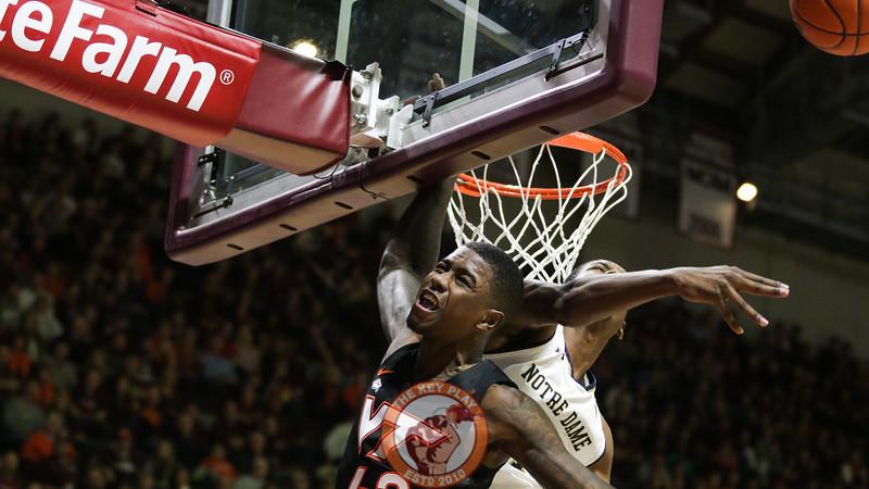Ty Outlaw gets a shot blocked underneath the basket by Notre Dame's Juwan Durham. (Mark Umansky/TheKeyPlay.com)