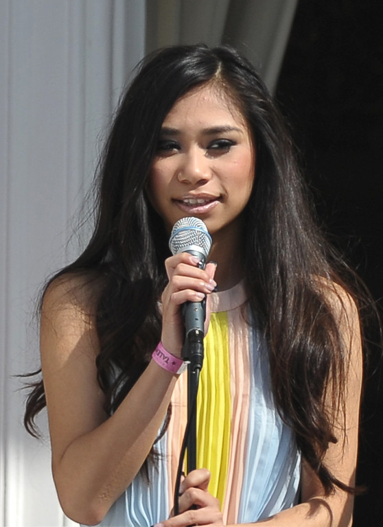 . Jessica Sanchez performs the US National Anthem at the start of the annual Easter Egg Roll on April 1, 2013 at the White House in Washington, DC. AFP PHOTO/Mandel NGAN/AFP/Getty Images