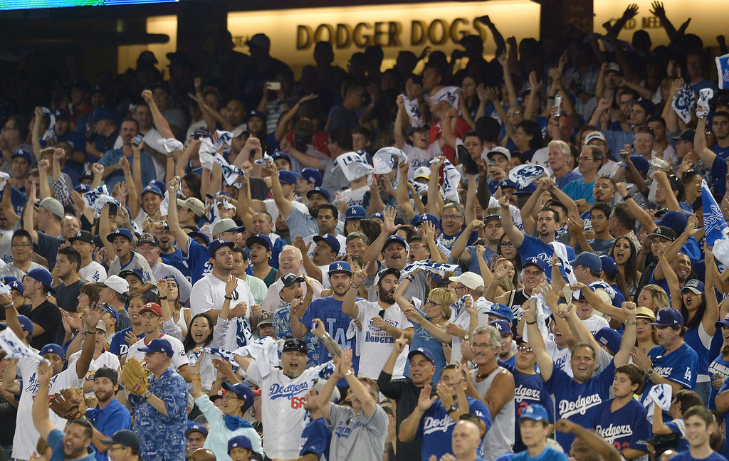 . Fans cheer in the 9th inning as the Dodgers defeated the Cardinals 3-2 in game 2 of the NLDS at Dodger Stadium in Los Angeles, CA. 10/4//2014(Photo by John McCoy Daily News )