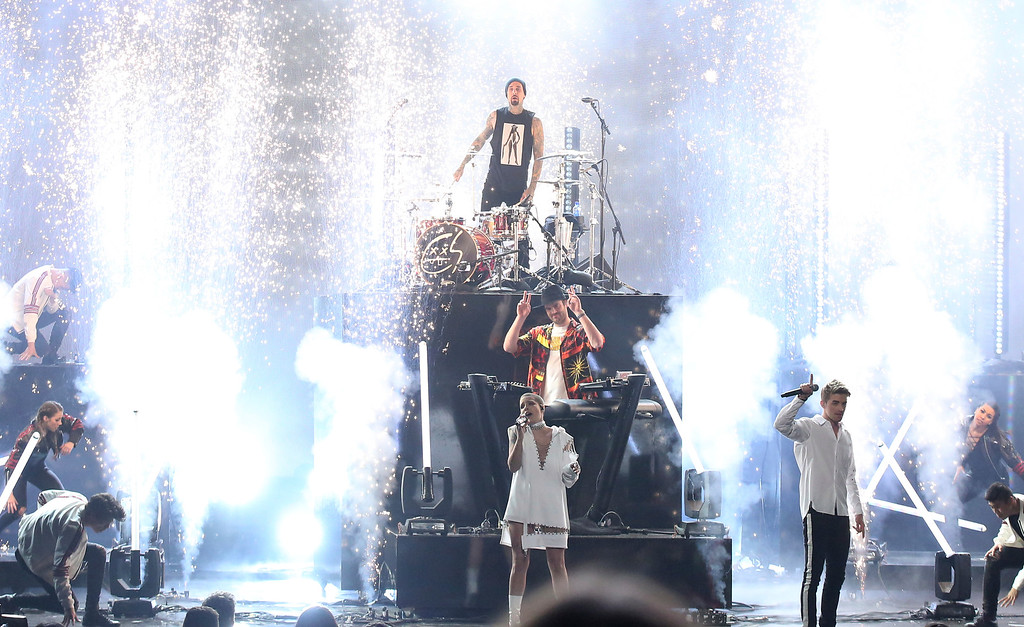 ". Halsey, bottom center, Travis Barker, top center, and Alex Pall and Andrew Taggart, right, of The Chainsmokers, perform ""Closer\"" at the American Music Awards at the Microsoft Theater on Sunday, Nov. 20, 2016, in Los Angeles. (Photo by Matt Sayles/Invision/AP)"