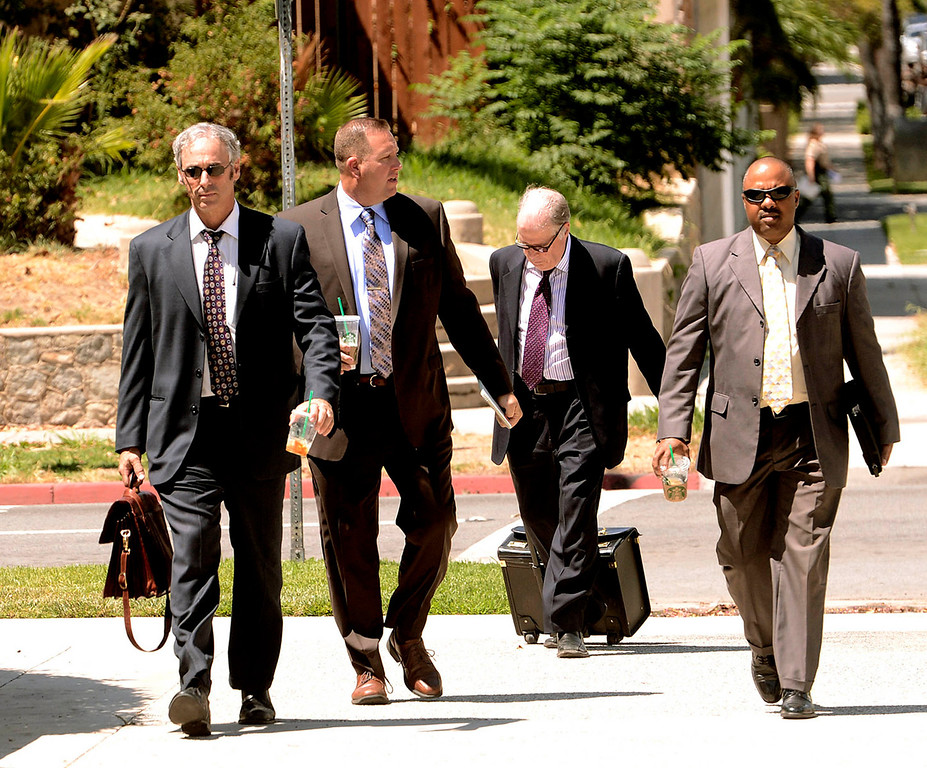 . Lawyers arrive to the United States Bankruptcy Court in Riverside August 28, 2013.  GABRIEL LUIS ACOSTA/STAFF PHOTOGRAPHER.