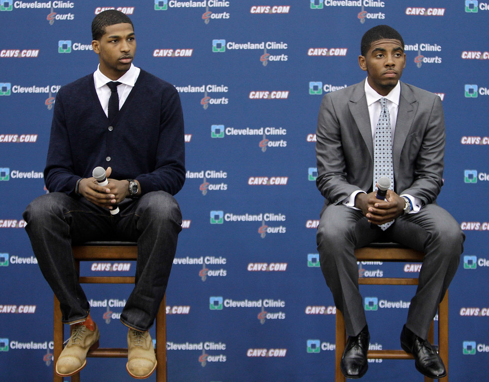 . Cleveland Cavaliers first round draft picks Tristan Thompson, left, and Kyrie Irving  listen to a question from the media during a basketballnews conference Friday, June 24, 2011, in Independence, Ohio. Irving was the No. 1 overall pick in the NBA Draft. Thompson was the No. 4 overall pick. (AP Photo/Tony Dejak)