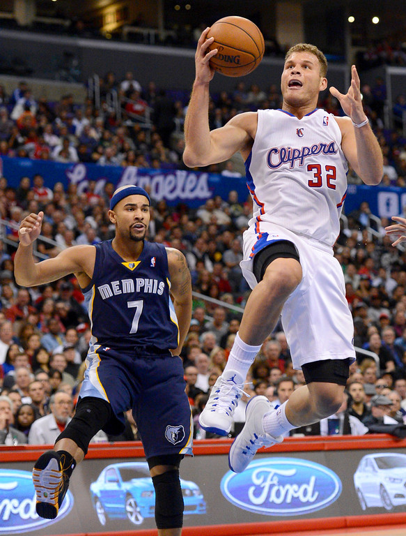 . Los Angeles Clippers\' Blake Griffin prepares to dunk the ball after getting by Jared Bayless of the Memphis Grizzlies during the first half Monday, Nov. 18, 2013, in Los Angeles.(Andy Holzman/Los Angeles Daily News)