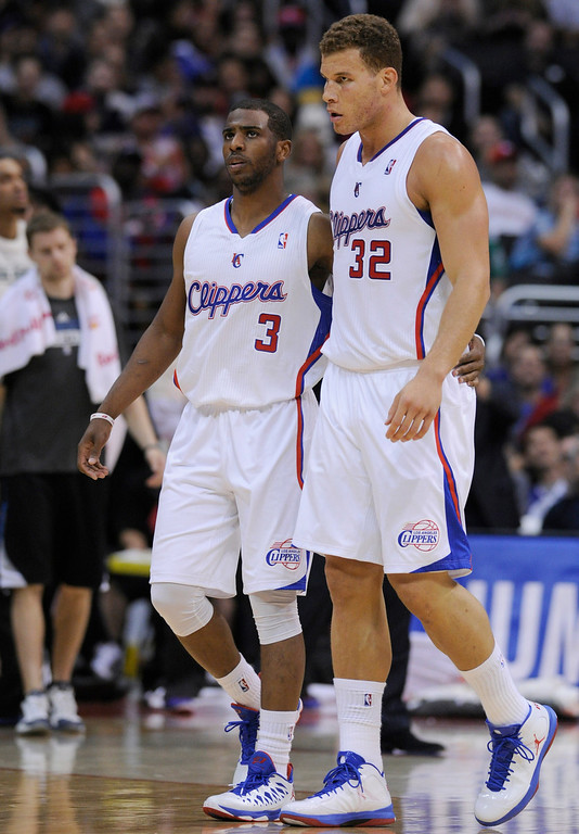 . Clippers#3 Chris Paul and Clippers#32 Blake Griffin walk off the floor at the end of the first half. The Clippers played the Minnesota Timberwolves in a game played at Staples Center in Los Angeles, CA 4/10/2013(John McCoy/Staff Photographer