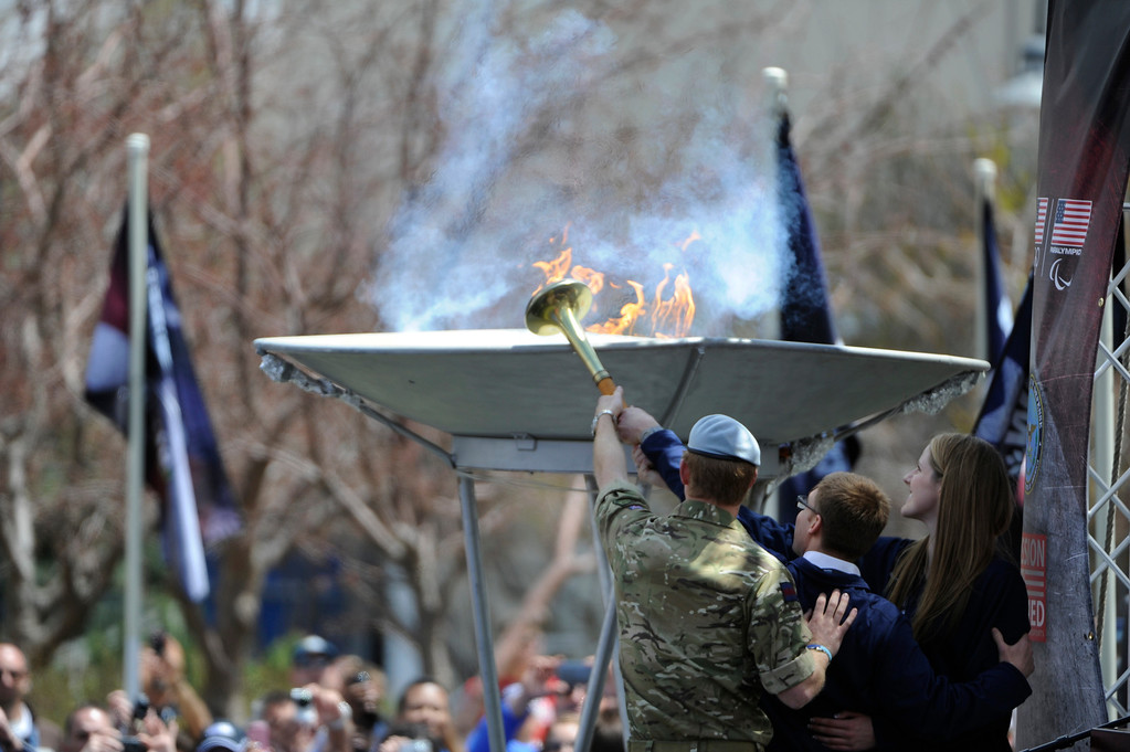 . COLORADO SPRINGS, CO - MAY 11: Left to right, Prince Harry of Wales, Paralympian Bradley Snyder, and Olympian, Missy Franklin, light the 2013 Warrior Games cauldron during opening ceremonies at the United States Olympic Training Center, Saturday afternoon, May 11th, 2013. (Photo By Andy Cross/The Denver Post)