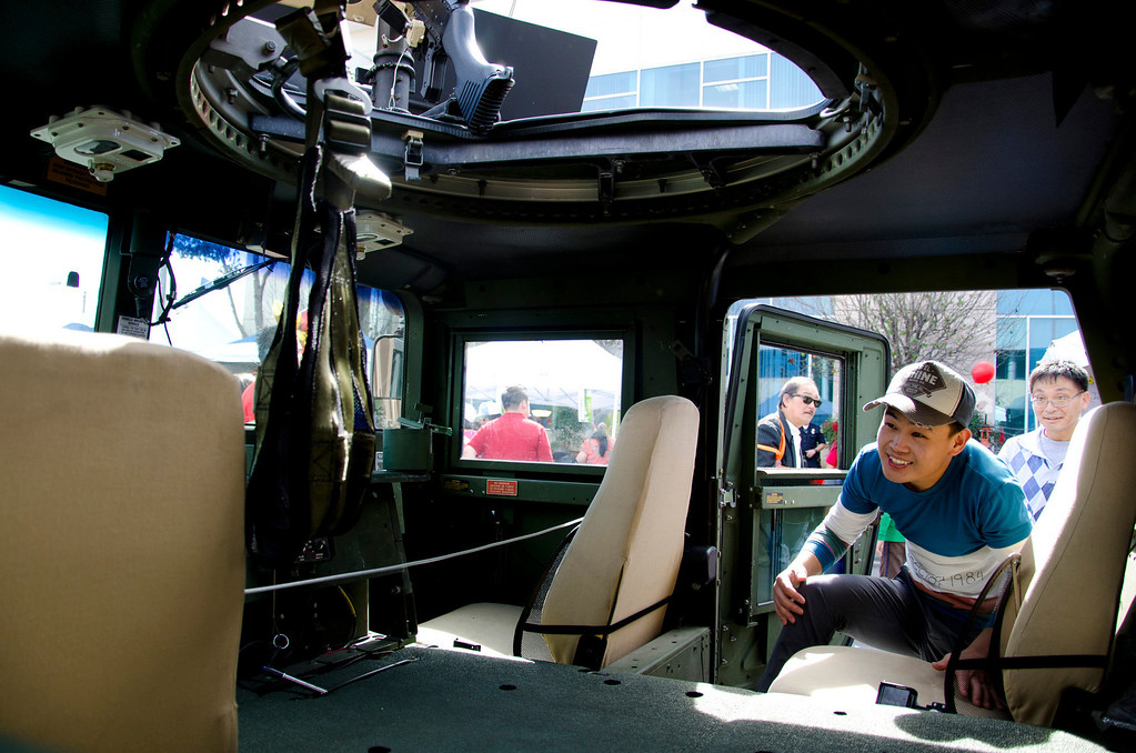 . Ryan Kong of San Gabriel jumps into a humvee on display to the public during the 22nd Annual Alhambra Lunar New Year Celebration in Alhambra, Calif., Saturday, Feb. 16, 2013. The celebration included food, rides, games and entertainment. (SGVN/Correspondent photo by Anibal Ortiz)