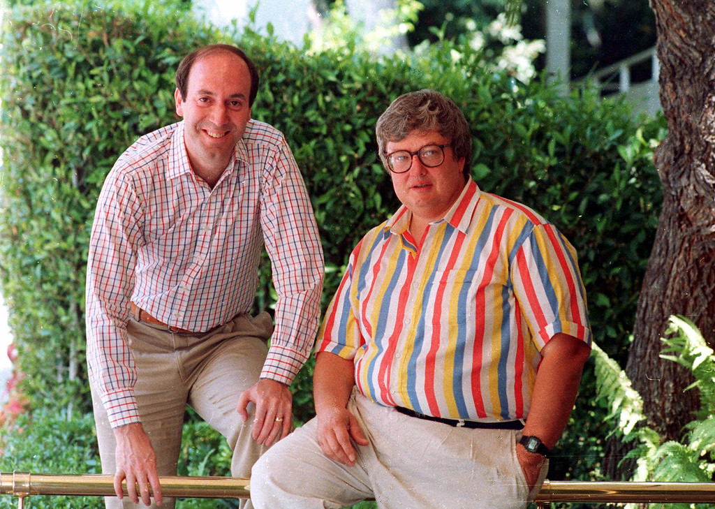 """. Roger Ebert, right, poses with Gene Siskel in Los Angeles in this 1986 photo.  The rivalry between the two Chicago film critics who combine their talents on the movie review show \""""Siskel & Ebert & The Movies\"""" has helped make them media stars.  (AP Photo/DOUGLAS C. PIZAC)"""
