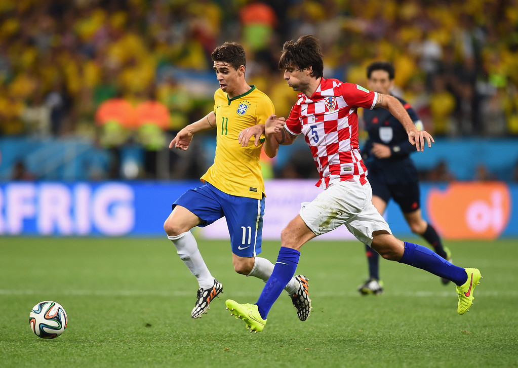 . Oscar of Brazil dribbles toward the goal past Vedran Corluka of Croatia during the 2014 FIFA World Cup Brazil Group A match between Brazil and Croatia at Arena de Sao Paulo on June 12, 2014 in Sao Paulo, Brazil.  (Photo by Buda Mendes/Getty Images)