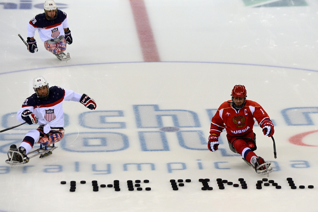 . United States\' Rico Roman (L) and Russia\'s Dmitrii Lysov (R) warm up before Sledge Hockey Final match between Russia and USA at XI Paralympic Olympic games in the Shayba stadium close to city of Sochi on March 15, 2014. AFP PHOTO/KIRILL KUDRYAVTSEV/AFP/Getty Images