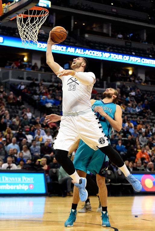 . Jusuf Nurkic (23) of the Denver Nuggets scores on a layup over Frank Kaminsky III (44) of the Charlotte Hornets during the first quarter. The Denver Nuggets hosted the Charlotte Hornets at the Pepsi Center on Sunday, January 10, 2016. (Photo by AAron Ontiveroz/The Denver Post)