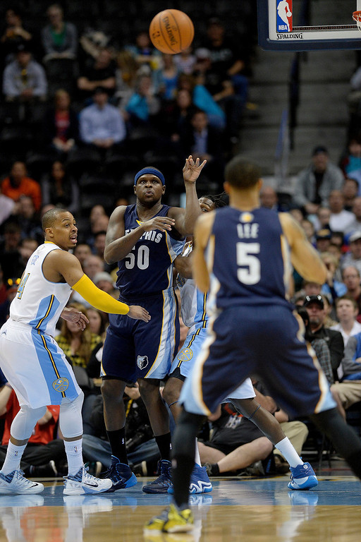 . Memphis Grizzlies forward Zach Randolph (50) kicks a pass out to guard Courtney Lee (5) as Denver Nuggets guard Randy Foye (4) defends during the first quarter. (Photo by AAron Ontiveroz/The Denver Post)