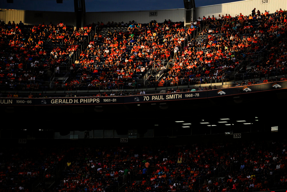 . Afternoon light streams into the stadium during a preseason game between the Denver Broncos and the Seattle Seahawks at Sports Authority Field at Mile High on Thursday, August 07, 2014 in Denver, Colorado.  (Photo by Kent Nishimura/The Denver Post)