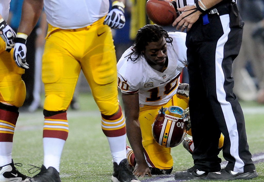 . Washington Redskins quarterback Robert Griffin III gets up after he was sacked by Minnesota Vikings defensive end Everson Griffen for a 10-yard loss during the fourth quarter. (Pioneer Press: Sherri LaRose-Chiglo)