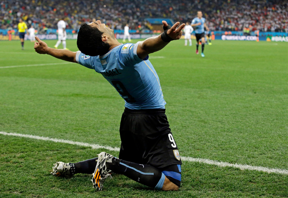 . Uruguay\'s Luis Suarez celebrates after scoring his side\'s second goal during the group D World Cup soccer match between Uruguay and England at the Itaquerao Stadium in Sao Paulo, Brazil, Thursday, June 19, 2014.  (AP Photo/Matt Dunham)