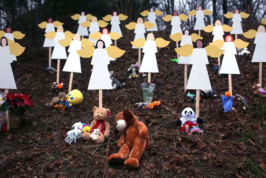 . NEWTOWN, CT - DECEMBER 16:  Twenty seven wooden stand in a yard down the street from the Sandy Hook School December 16, 2012 in Newtown, Connecticut. Twenty-six people were shot dead, including twenty children, after a gunman identified as Adam Lanza opened fire at Sandy Hook Elementary School. Lanza also reportedly had committed suicide at the scene. A 28th person, believed to be Nancy Lanza, found dead in a house in town, was also believed to have been shot by Adam Lanza.  (Photo by Spencer Platt/Getty Images)