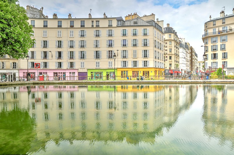 Colorful shops along the Canal St. Martin in the 10th arrondissement - Paris, France