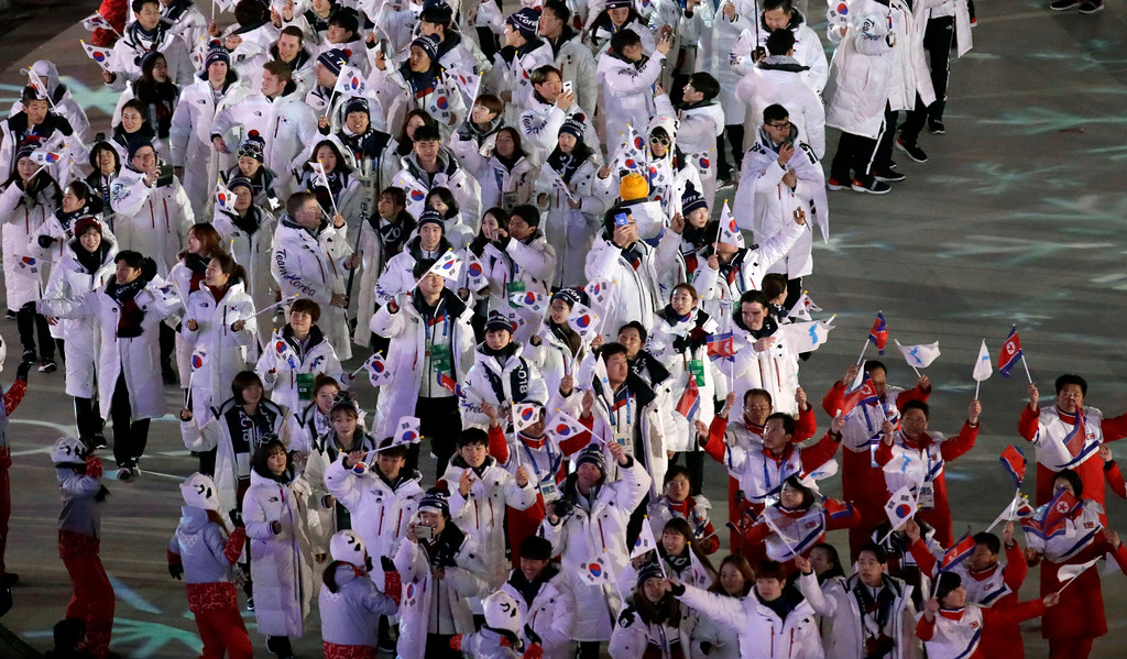 . North Korean athletes, bottom right, walk ahead of South Korean athletes as they march into the stadium during the closing ceremony of the 2018 Winter Olympics in Pyeongchang, South Korea, Sunday, Feb. 25, 2018. (AP Photo/Aaron Favila)