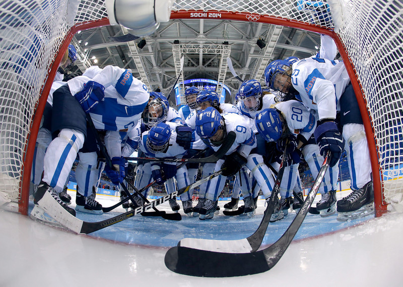 . Finland huddle around the net before the Women\'s Classifications Game against Russia on day 11 of the Sochi 2014 Winter Olympics at Shayba Arena on February 18, 2014 in Sochi, Russia.  (Photo by Matt Slocum - Pool/Getty Images)