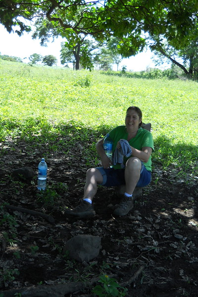 woman sitting in the shade after long hike