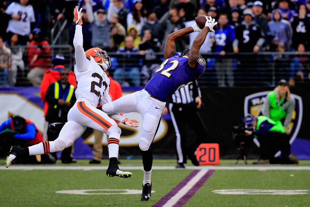 . BALTIMORE, MD - DECEMBER 28:  Wide receiver Torrey Smith #82 of the Baltimore Ravens makes a fourth quarter catch past the defense of cornerback Joe Haden #23 of the Cleveland Browns at M&T Bank Stadium on December 28, 2014 in Baltimore, Maryland.  (Photo by Rob Carr/Getty Images)