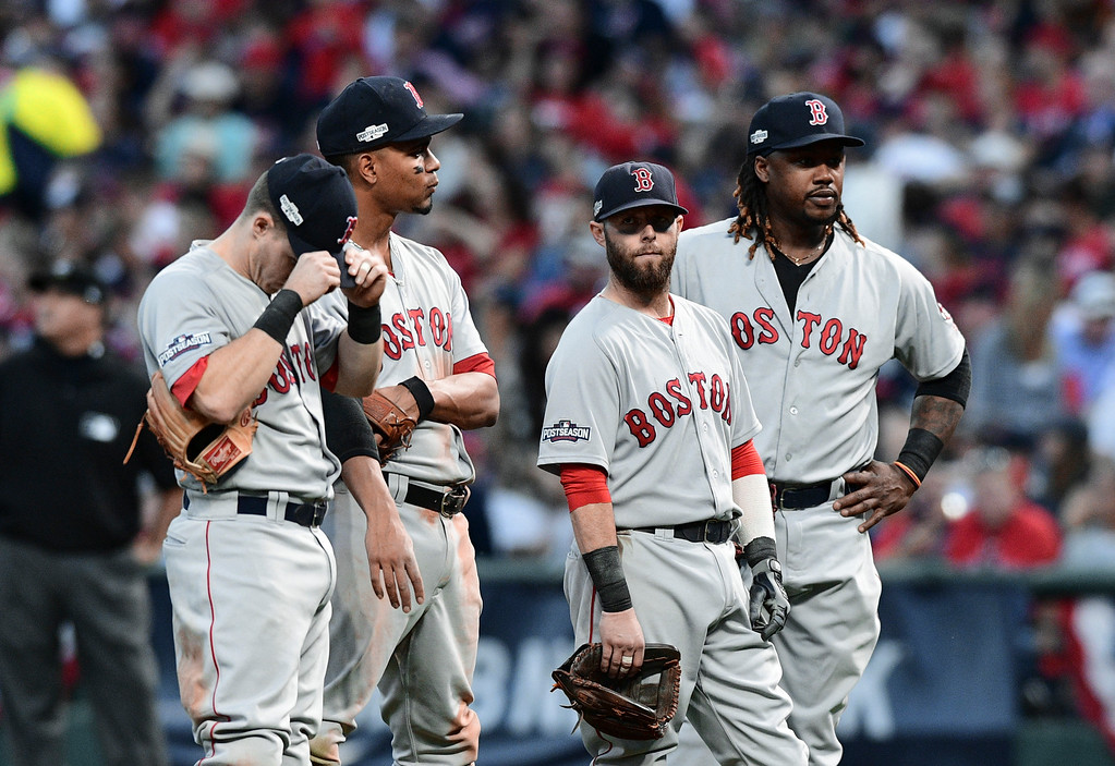 . Boston Red Sox infielders, from left to right, Brock Holt, Xander Bogaerts, Dustin Pedroia and Hanley Ramirez wait during a pitching change in the sixth inning during Game 2 of baseball\'s American League Division Series against the Cleveland Indians, Friday, Oct. 7, 2016, in Cleveland. (AP Photo/David Dermer)