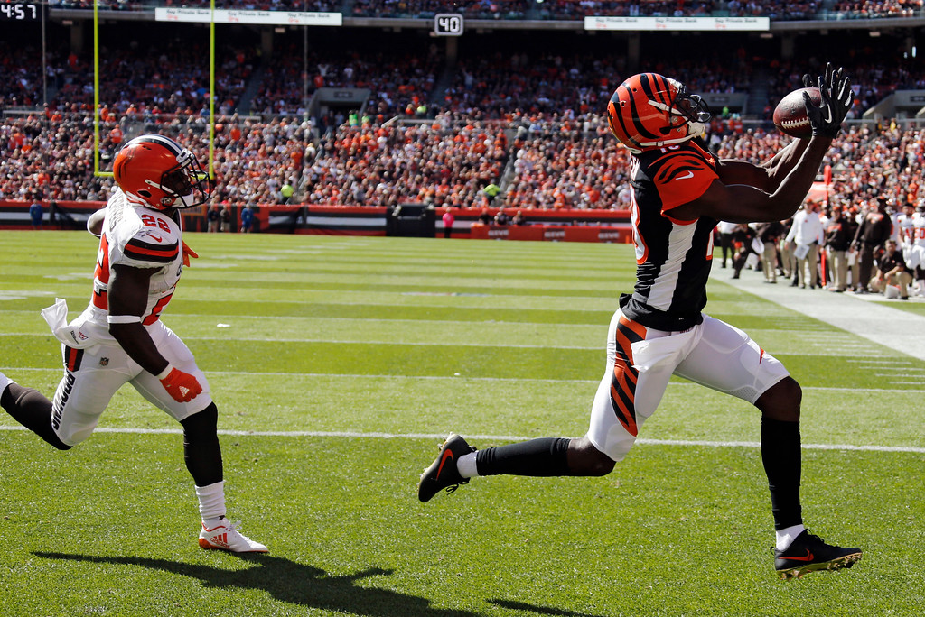 . Cincinnati Bengals wide receiver A.J. Green, right, reaches for a ball after a 7-yard pass for a touchdown in the first half of an NFL football game against the Cleveland Browns, Sunday, Oct. 1, 2017, in Cleveland. (AP Photo/Ron Schwane)