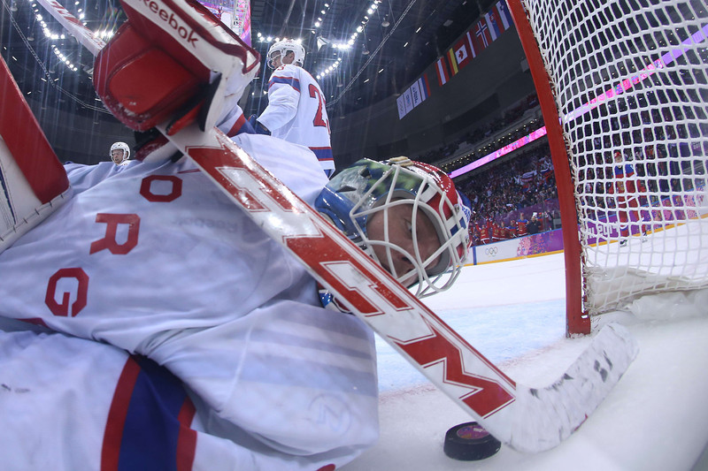 . Norway\'s goalkeeper Lars Haugen eyes the puck in his net during the Men\'s Ice Hockey play-offs qualification match Russia vs Norway at the Bolshoy Ice Dome during the Sochi Winter Olympics on February 18, 2014.  (BRUCE BENNETT/AFP/Getty Images)