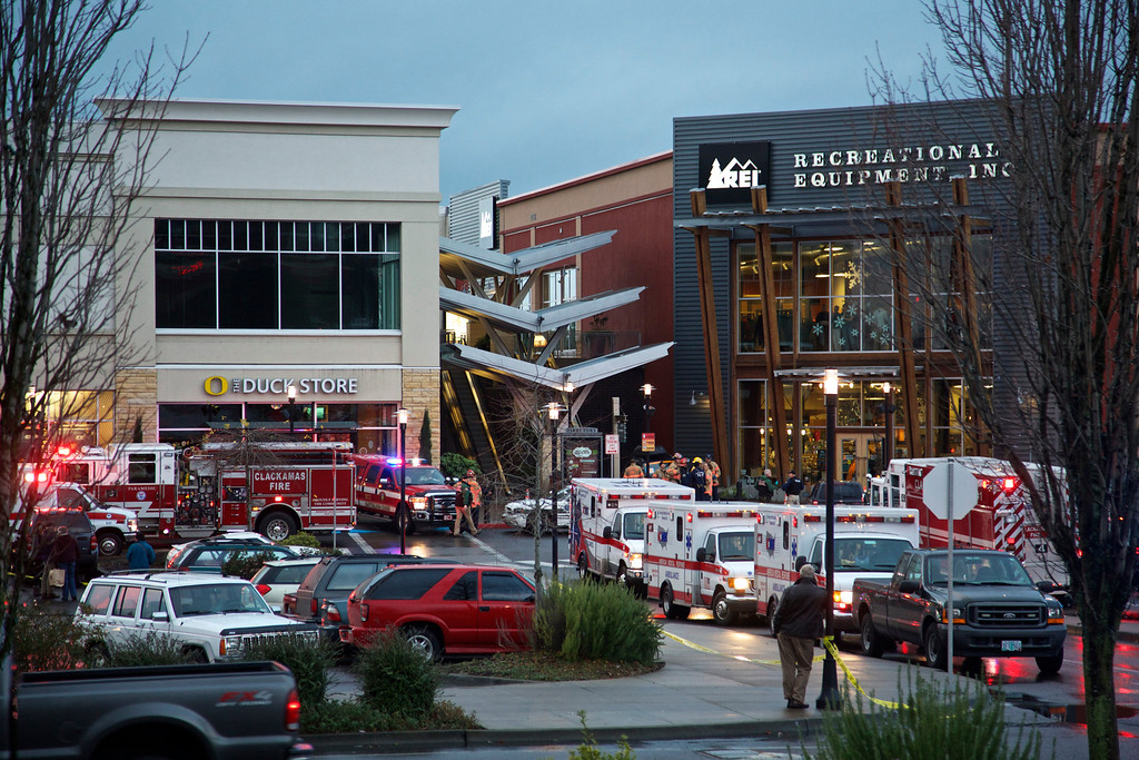 . Emergency personnel stage an area outside the Clackamas Town Center in Portland, Ore., where a shooting occurred, Tuesday, Dec. 11, 2012. Witnesses say the scene went from cheery to chaotic in seconds when a gunman opened fire in the suburban Portland shopping mall Tuesday, killing two people and wounding another. (AP Photo/The Oregonian, Thomas Boyd)