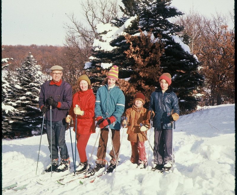 . NORSKE of White Bear: �Subject: NORTH OAKS SKI RESORT. A ski club was organized by my father and other White Bear skiers in 1950. They contacted Louis Hill at North Oaks for permission to use a hill on his property for skiing. A large electric motor was installed for a rope tow. The ski hill had a vertical drop of 90 feet, the largest in the area. Pine trees on the open slope and trails through the woods made it challenging. It was humorously called �Old Suicide�! In the fall, club members gathered to remove brush from the hill, and, after the first snowfall, to side-step with their skis to pack the snow. It was an ideal place for parents to teach their children to ski. The ski area was shut down at the end of the 1970s over concerns about liability insurance. In this picture, I am with my wife, Carolyn, and our children, Pam, Erik, and Diana, in 1977. �
