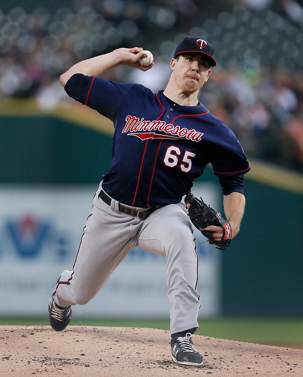 . Minnesota Twins pitcher Trevor May throws against the Detroit Tigers in the first inning of a baseball game in Detroit, Thursday, Sept. 25, 2014. (AP Photo/Paul Sancya)