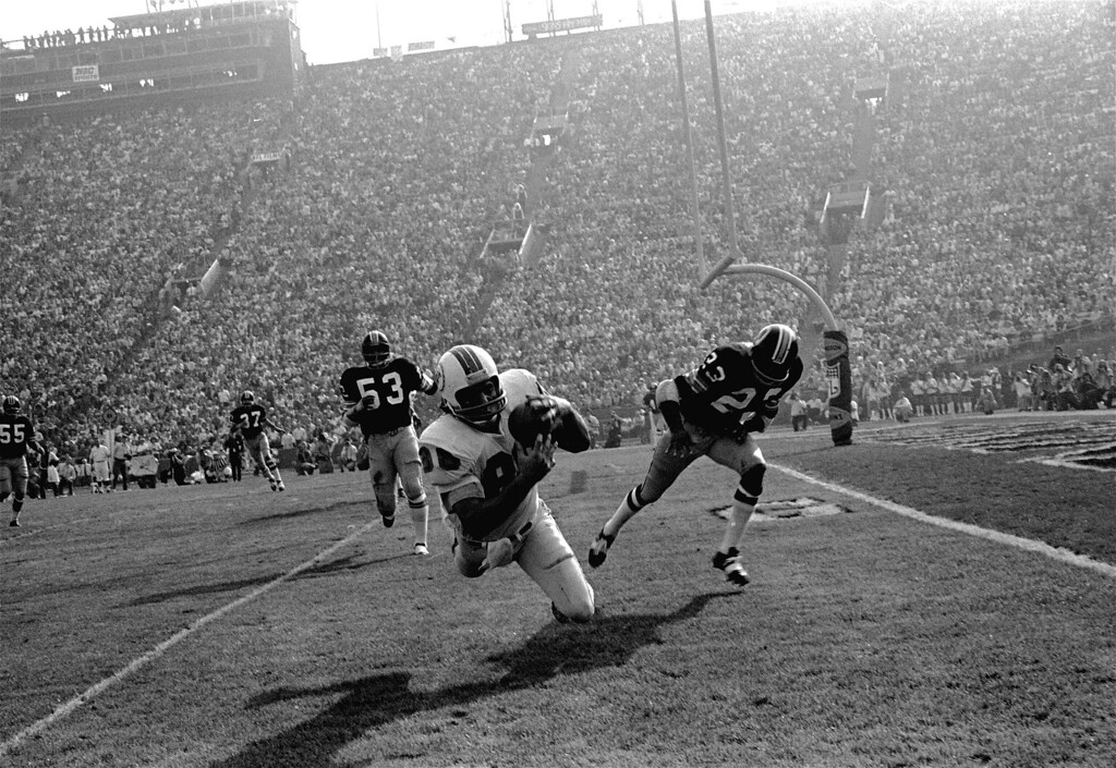 . Miami Dolphins\' Jim Mandich takes in a Bob Griese pass near the goal line during the second quarter of Super Bowl VII against the Washington Redskins in Los Angeles today, January 14, 1973.  The pass came just before the second Miami TD.  Chasing Mandich are Harold McLinton (53) and Brig Owens (23).  Miami won 14-7. (AP Photo/stf)