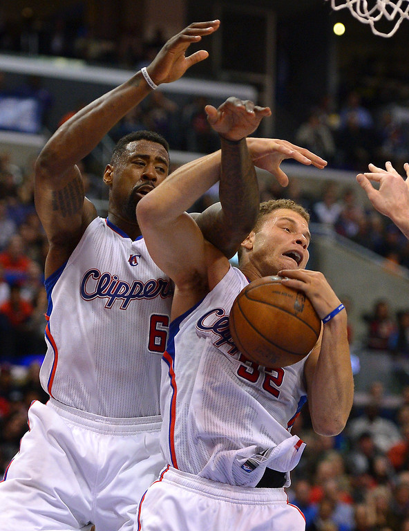 . Clippers\' DeAndre Jordan and Blake Griffin get tangled during a rebound. (Photo by Michael Owen Baker/L.A. Daily News)
